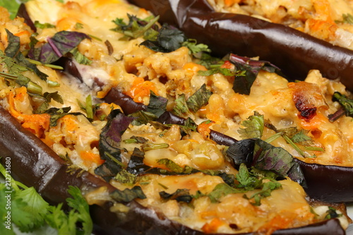 Spoed Fotobehang Eten Stuffed eggplant with meat and vegetables with cheese, baked in the oven