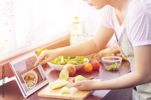 Foto op Plexiglas Koken Asian woman prepare ingredients for cooking follow cooking class online course on website via tablet. cooking content on internet technology for modern lifestyle concept