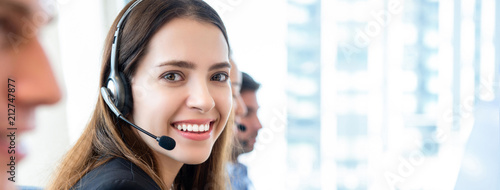 Obraz Beautiful woman in call center banner gackground - fototapety do salonu