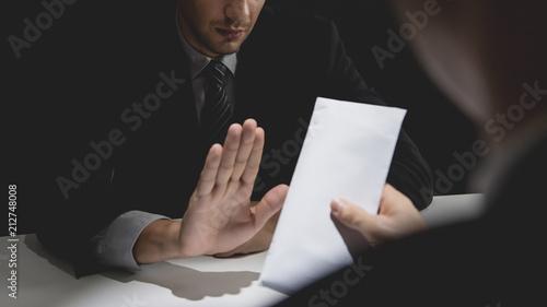 Businessman rejecting money in white envelope Fototapet