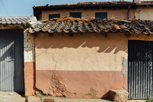 Clay Roof Tiles Shadow Over Orange Wall In A Rural House