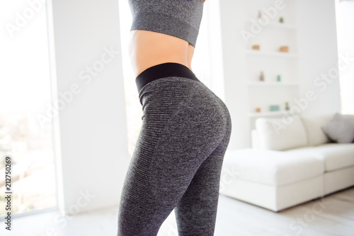 Obraz Weightloss wellness eating nutrition vitality concept. Cropped close up view photo of sexual sporty sportive tempting beautiful attractive nice round ass wearing gray tight pants leggings - fototapety do salonu