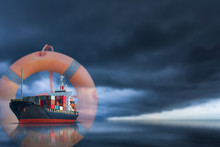 Cargo Container Ship With Lifebuoy Ring And Floating Rope On Storm Sky Background Theme Insurance Safety Concept.