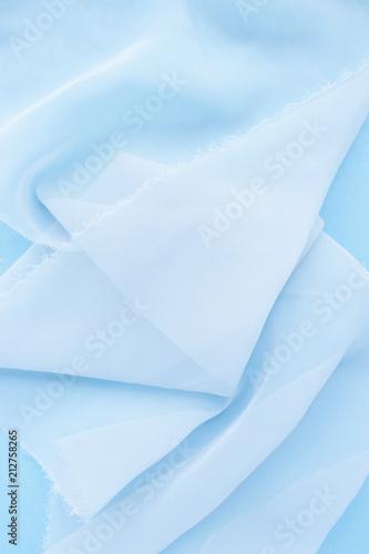 Fotografie, Obraz  Chiffon cloth on a blue pastel background