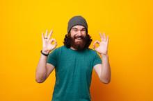 Cheerful Young Bearded Man Loo...