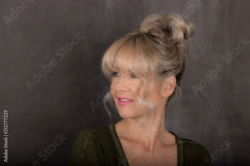 Fotografie, Obraz  Woman With Blonde Bun and Bangs Hairstyle