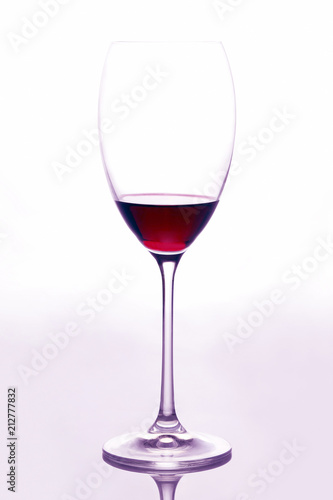 Staande foto Alcohol glass with red wine on a light background
