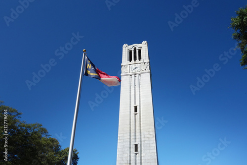 Fototapeta Bell tower and state flag obraz