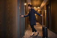 Businesswoman Entering In Hotel Room