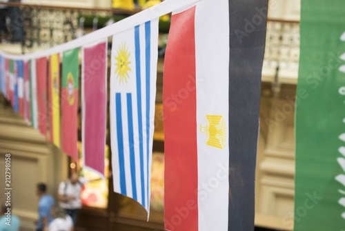 Fototapety, obrazy: Flags of many countries hang from the ceiling on the ropes in the Mall