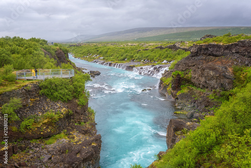 Printed kitchen splashbacks Air photo Hraunfossar waterfalls or Lava Falls, Iceland. Beautiful summer landscape, water is flowing through the lava rocks into the emerald colored Hvita river. One of the most unusual waterfalls in Iceland