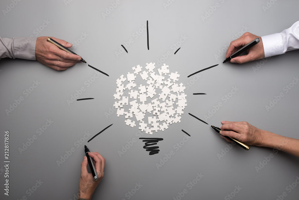 Fototapeta Top view of  white scattered puzzle pieces and businesspeople hands
