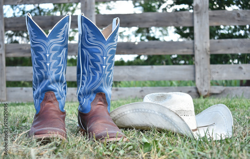 Fotografie, Tablou cowboy boots and hat with a farm gate