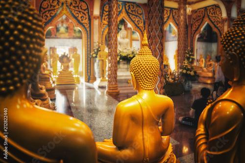 Foto op Plexiglas Bedehuis buddhist temple with golden buddha vishnu gods statue praying - phuket, thailand