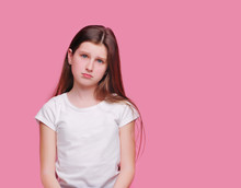 Sad Brunette Teen Girl Against Pink Background