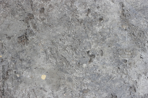 Fototapeta Abstract dirty rough holey perforated unpolished cement concrete texture obraz