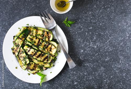Fototapeta Grilled zucchini with basil and olive oil obraz