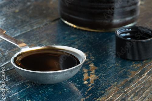 Fotografia, Obraz  A tablespoon of Worcestershire sauce