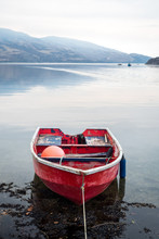Calm Water And Rowboat