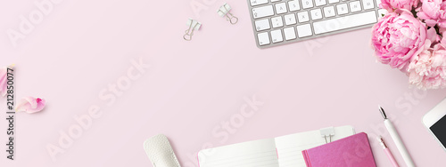 Foto auf AluDibond Blumen feminine banner or shop header with office / writing supplies, technical gadgets, smartphone and a bunch of pink flowers on a pink background - copyspace for your text and branding - top view