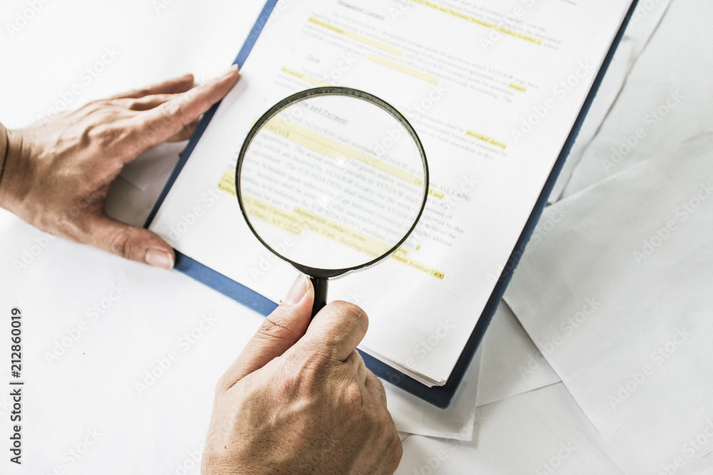 Fototapety, obrazy: Legal team checking the fine print on business contract to analyze terms and conditions and sign.