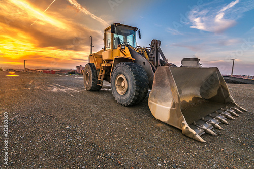 Excavator at the end of a working day in a construction site