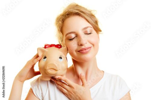 Deurstickers Wanddecoratie met eigen foto Junge Frau mit Sparschwein als Sparsamkeit Konzept