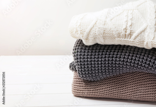 Fotografie, Obraz  Warm knitted winter sweaters in stack