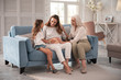 Three generations. Pregnant woman feeling simply amazing sitting between her mother and daughter
