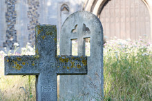 English Country Cemetary With Ancient Stone Cross Headstone In Rural Churchyard