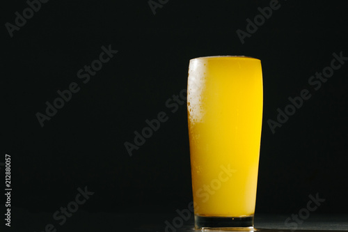 Foto op Aluminium Bier / Cider Glass beer with foam on black background with copyspace
