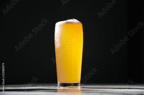 Foto op Plexiglas Bier / Cider Glass beer with foam on black background with copyspace