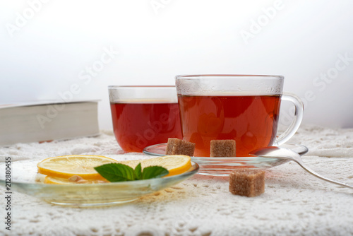 Staande foto Thee hot black tea with lemon and mint fragrant fresh glass glass still life hand glass