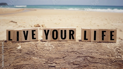 Fotografie, Obraz  Motivational and inspirational quote - 'Live Your Life' written on wooden blocks