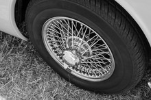 Classic Car Wire Wheel In Black And White