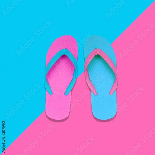 Pink and Blue Flip Flops on pastel colors background