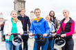canvas print picture - Tourist group having guided Segway city tour in Germany