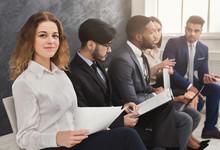 Multiracial People Waiting In Queue Preparing For Job Interview