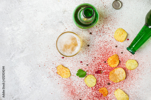 Foto op Aluminium Buffet, Bar Food background. Potato chips, beer and spices flat lay