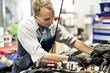 Handsome mechanic job in uniform working on car