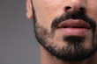 Leinwandbild Motiv Close up on the mouth and chin of a bearded man