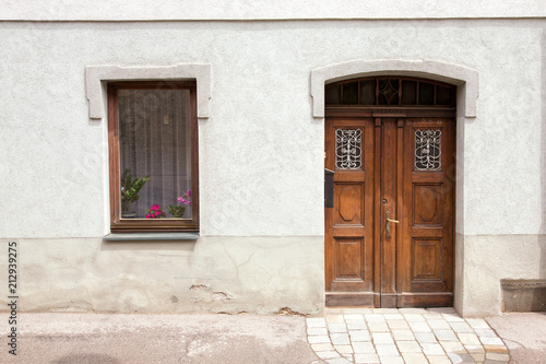 Old European housing front / facade with plastered walls and antique doors. - Old European Housing Front / Facade With Plastered Walls And Antique