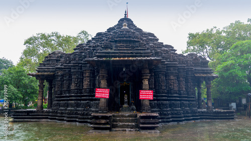 Foto op Plexiglas Bedehuis Image of Ambreshwar Shiv Temple In Heavy Rain, Full shot, Historic 11th-century Hindu temple, Ambarnath, Maharashtra, India