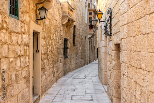 Canvas Prints Narrow alley beautiful view of ancient narrow medieval street town Mdina, Malta