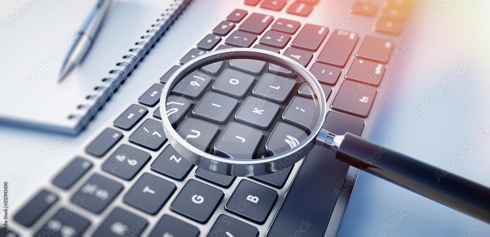 Fototapeta Lupe auf schwarzer Tastatur