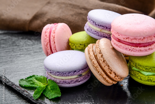 Foto auf Gartenposter Macarons Stack of macarons, macaroons French cookie