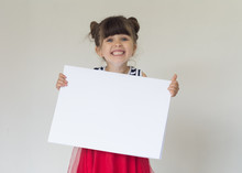 Smiling Girl With White Blank. Advertising Place For You, Empty Card, Cute Kid Holding It.