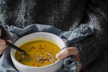 Girl Eating Pumpkin Soup