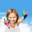 Little girl with colorful painted hands
