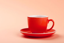 Red Cup Of Tea Or Coffee Over Pink Background